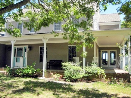 West Dennis Cape Cod vacation rental - Front of house with covered porch and rocking chairs.