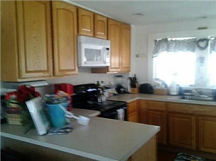 West Yarmouth Cape Cod vacation rental - Fully equipped kitchen w/breakfast nook