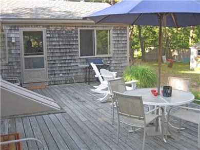 Brewster Cape Cod vacation rental - Rear Deck With Family Room Addition Visible