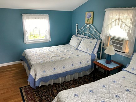 Hyannis Cape Cod vacation rental - One of five bedrooms.  This one with 2 double beds.