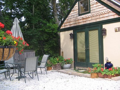 Chatham Village Cape Cod vacation rental - Patio from living area w/ furniture for eating & relaxing outside