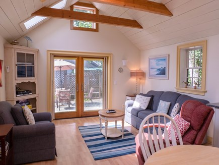 Chatham Village Cape Cod vacation rental - Living room facing outdoors with overhead fan