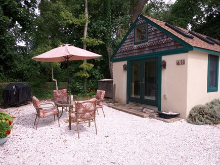 Chatham Village Cape Cod vacation rental - Patio w/ furniture for eating & relaxing outside with nature