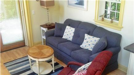 Chatham Village Cape Cod vacation rental - Cozy living room w/sleeper couch & French doors to patio