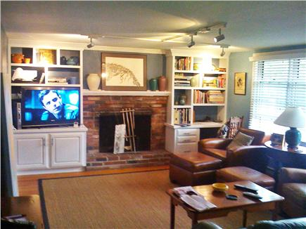Provincetown Cape Cod vacation rental - Living Room featuring Sony HDTV, built-in bookcases and fireplace