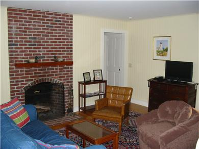 Eastham Cape Cod vacation rental - Working fireplace, comfortable sofa & chairs, flat screen TV/DVD