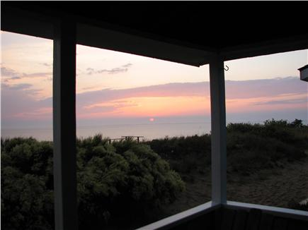 Truro - Corn Hill Cape Cod vacation rental - An evening view looking out from the cottage porch