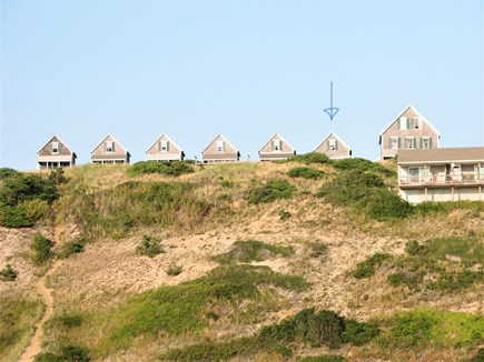 Truro - Corn Hill Cape Cod vacation rental - Looking up the dune from our private beachArrow is our cottage