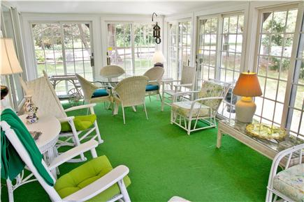 East Orleans Cape Cod vacation rental - Large sunny porch with dining area