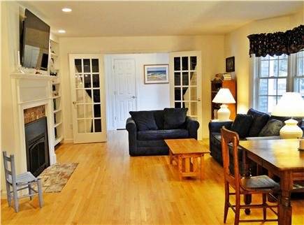 Eastham - Herring Pond Cape Cod vacation rental - Living room with bay window, fireplace, TV and comfy couches