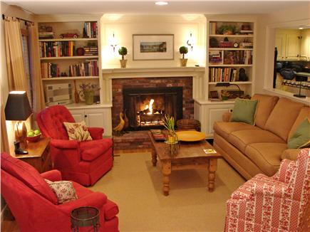 East Falmouth Cape Cod vacation rental - Living room with fireplace, adjacent to dining