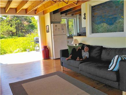 Truro Cape Cod vacation rental - French doors open onto sunny deck; pic shows living area