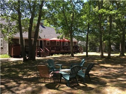 North Eastham Cape Cod vacation rental - Huge, level and fenced backyard with playground & privacy!