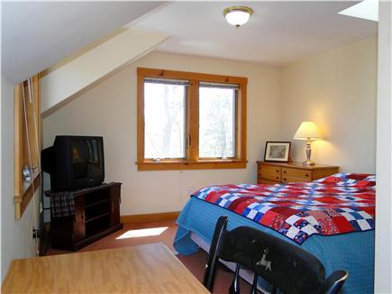 Hyannis Cape Cod vacation rental - Master queen bedroom with TV, desk, skylight, bathroom access