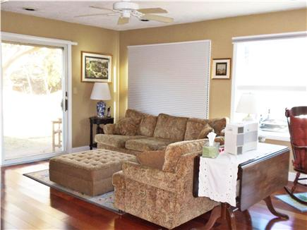 South Chatham Cape Cod vacation rental - 1st floor living room with doors to patio and hot tub
