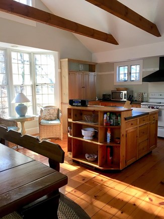 Harwich Cape Cod vacation rental - Eat in kitchen for 8 with large island and reading nook.