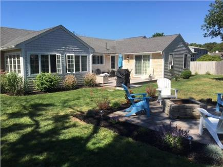 West Dennis Cape Cod vacation rental - Spacious private fenced in back yard with fire pit