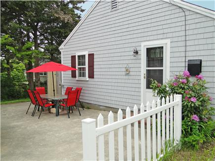 Dennis Cape Cod vacation rental - Patio w/ grill – near outdoor shower and bonus room in cottage