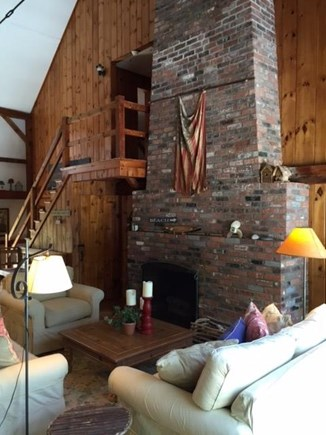 East Sandwich Cape Cod vacation rental - Great Room fireplace and seating area - note: 25' vaulted ceiling