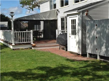 Dennis Cape Cod vacation rental - Backyard shower, screened-in porch and walk-out from lower level
