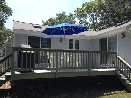 Mashpee, Popponesset Beach Cape Cod vacation rental - Back deck with gas grill and table/chairs.