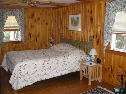 Eastham Cape Cod vacation rental - Spacious queen bedroom with knotty panneling