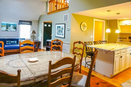 East Orleans Cape Cod vacation rental - Dining table sitting 6-8 looking into kitchen