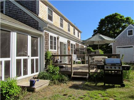 North Eastham Cape Cod vacation rental - Back yard with deck, gas grill, outdoor shower and screened porch