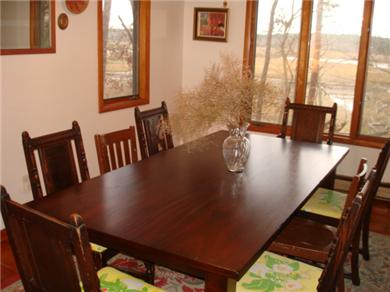 Wellfleet Cape Cod vacation rental - Dining table with water views, grilling deck access close too!