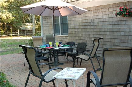 Eastham Cape Cod vacation rental - patio backyard includes horseshoe pit, cornhole & firepit