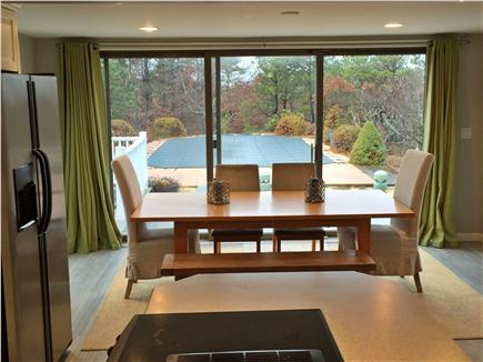 North Eastham Cape Cod vacation rental - Dining Room leading to deck and pool areas