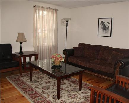 Brewster Cape Cod vacation rental - Living room with fireplace, library & room for great conversation
