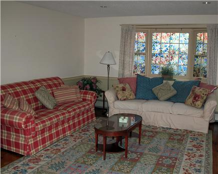 Brewster Cape Cod vacation rental - Large sunny family room with HD cable tv, DVD and access to deck