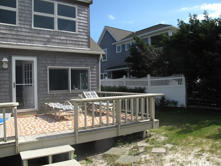 Brewster Cape Cod vacation rental - Water facing deck with dining and lounging options