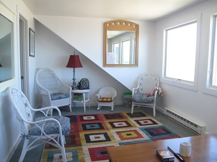 Brewster Cape Cod vacation rental - Upstairs sitting room- ( full futon  is behind coffee table)