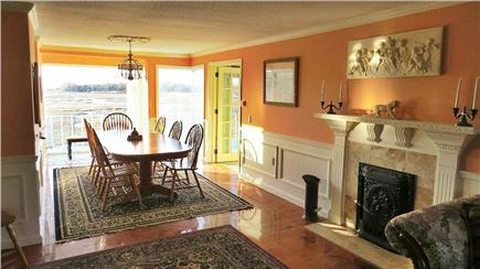 Orleans Cape Cod vacation rental - Living area to dining room (seats 10) w/marsh & water views