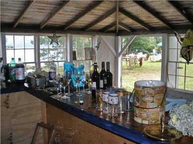 Dennis, Scargo Lake Cape Cod vacation rental - Interior of separate lakefront boathouse with full bar & stools