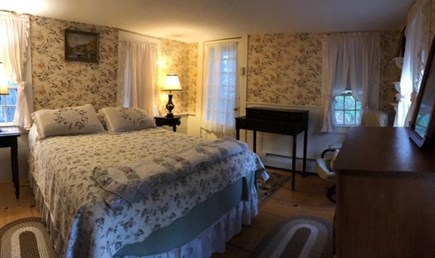 Dennis, Scargo Lake Cape Cod vacation rental - Bedroom with a door that opens to lawn leading to lakefront