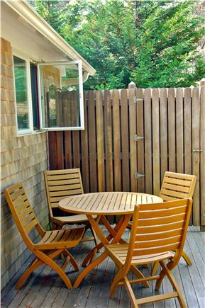 Wellfleet Cape Cod vacation rental - Side deck, cafe table and hot water outdoor shower
