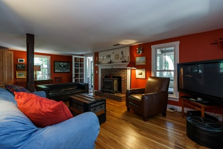 Truro Cape Cod vacation rental - The media/family room adjoins screened porch beyond.
