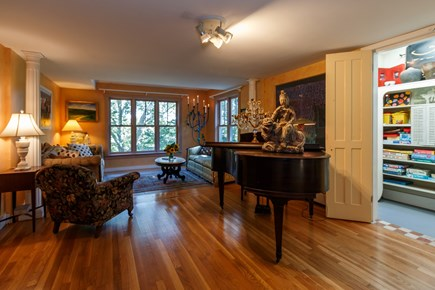 Truro Cape Cod vacation rental - Seating area, baby grand piano and well stocked game closet await