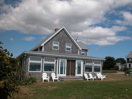 West Yarmouth Cape Cod vacation rental - Large grassy yard overlooks beach below