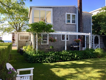 Provincetown, East End Cape Cod vacation rental - Back Yard With Glimpse of Ocean Across the Street.