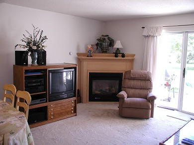 Brewster Cape Cod vacation rental - Living Room w/ fireplace & slider to private patio