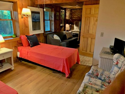 Chatham Cape Cod vacation rental - First floor bedroom with 2 twin beds, a sofa, & a window AC