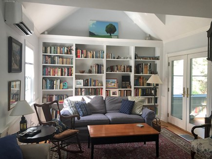 "Eastham Cape Cod vacation rental - Living Rm, wall of books, 47"" HDTV, Blu-Ray player, comfy seating"