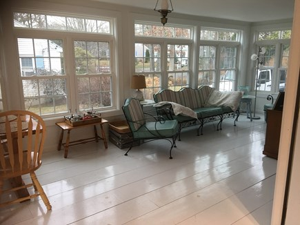 Dennis Cape Cod vacation rental - Bright and airy sunroom surrounded with windows and white floors