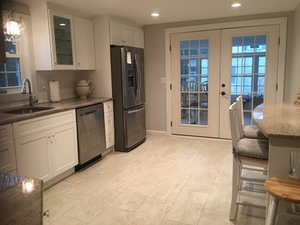 Dennis Cape Cod vacation rental - Kitchen french doors open wide to bright sunporch