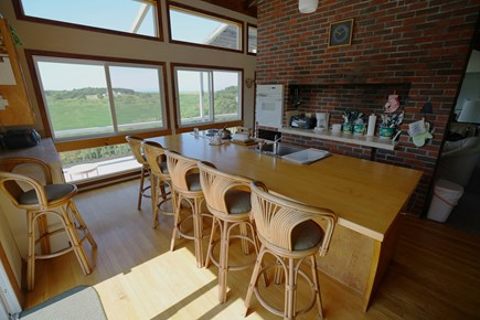 Truro Cape Cod vacation rental - Kitchen with incredible water view; 5 stools at center island