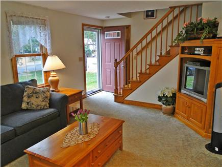 East Falmouth Cape Cod vacation rental - Living room with sectional and TV